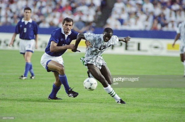 Samson Siasia in action during a match against Greece