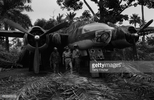 Soldiers posing in front of a captured plane, during the Nigerian conflict with Biafran forces, Nigeria, 1968.