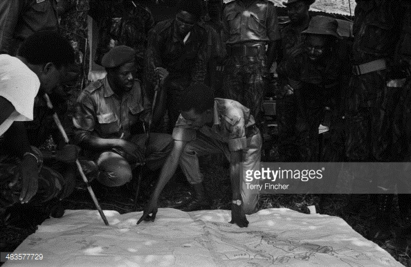 Nigerian Army Commander Benjamin Adekunle with his troops, looking at a map of Port Harcourt during the conflict with Biafran forces, 19th May Nigeria, 1968.