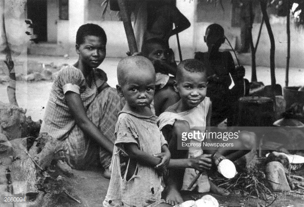 A starving Biafran family during the famine resulting from the Biafran War. (Photo by Express Newspapers