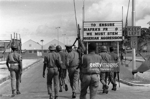 Nigerian troops entering Port Harcourt, after routing Biafran troops during the Biafran War.