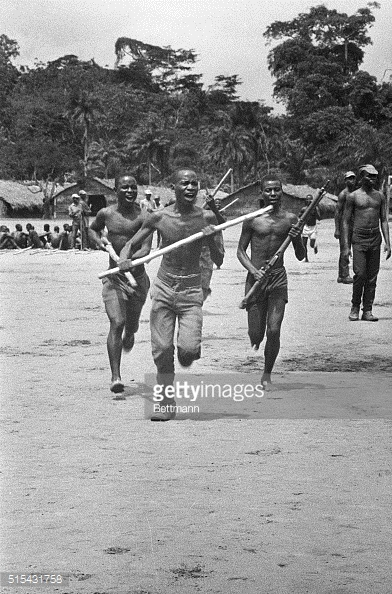 (Original Caption) 8/7/1968-Biafra, Africa- This is military training Biafran style. These recruits go through the paces somewhere in Biafra. Nigerian spokesmen have been meeting with a delegation from secessionist Biafra in peace talks in Ethiopia in a bid to end Nigeria's 13-month-old civil war. Meanwhile starvation threatens many in beseiged Biafra.